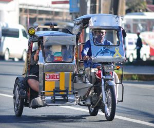 tricycle-street-boracay-philippines-march-motorized-tricycles-common-means-passenger-transport-52332666